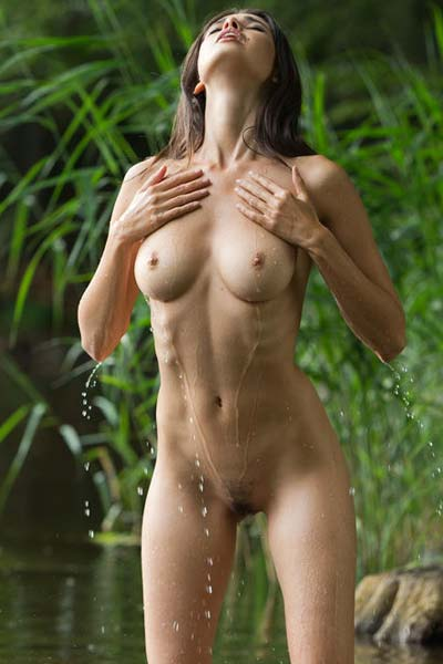 Nude Jasmine A gets in the shallow water