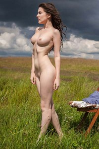 Erotical photo session with busty Doria A outdoors