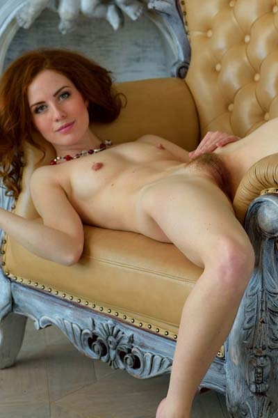 Sexy chick Adel P strips and poses in the armchair