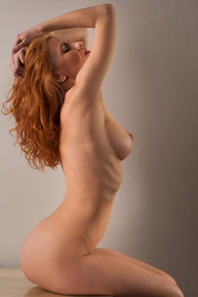 Natural redhead beauty Rada P poses naked for you