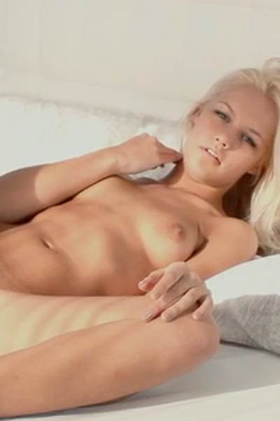 Alluring blonde Cristie T slowly takes off her panties for you