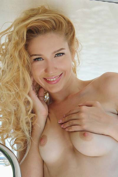 Xana D gets on the boat and undresses slowly