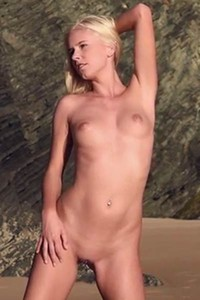 Skinny beauty Tracy A runs naked on the beach