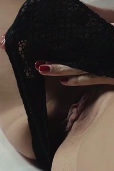 Hottie in black sheer lingerie Jana Q slowly steps in the nude