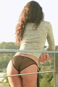 Adorable Carolina slowly strips on the balcony