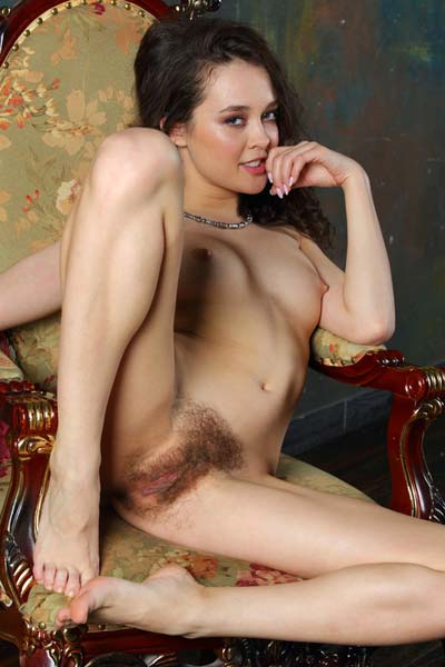 Voluptuous Marla O bares her hairy pussy while posing for the camera