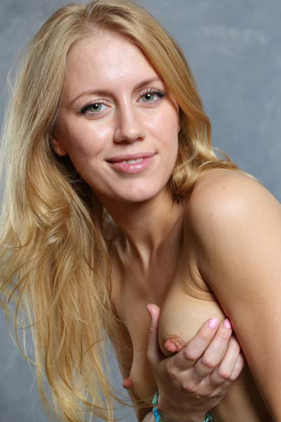 Dori K plays with her pink nipples before getting herself off