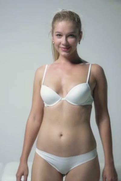 Xana D oils up her sexy body sensually on the camera