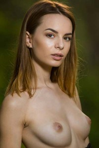 Busty Denisa G goes to the woods and undresses just for you