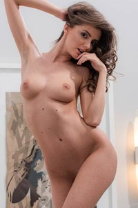 Horny busty brunette Fedra is ready to take it all off in the bedroom