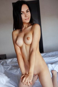 Alla S teases you as she cups her nice titties making them look bigger