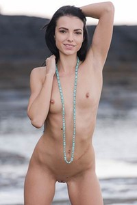 Top class babe Sapphira poses naked on the beach baring her magnificent skinny body