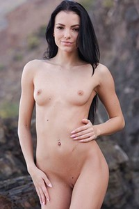 You just got an invitation to watch amazing babe posing naked on the rocks