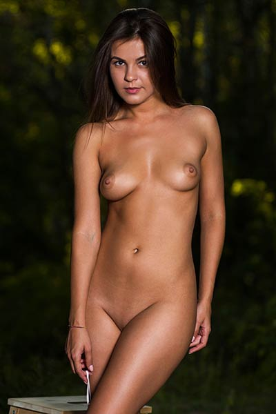 Arina B flaunts that sex appealing naked body of her while posing outdoors