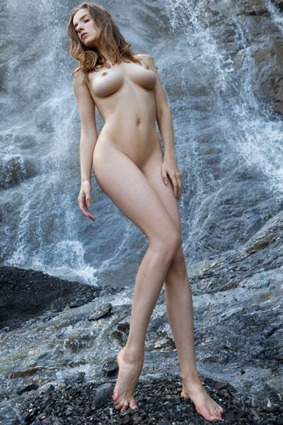 Brunette angel Mariposa shows off her body of a goddess as she poses naked by the waterfall