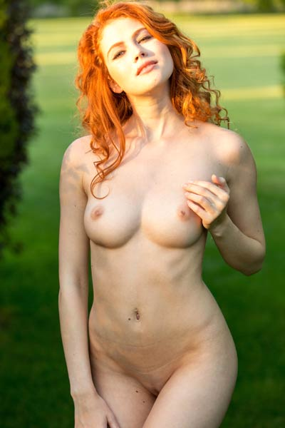 Curly ginger babe bares her outstanding all natural body while posing outdoors