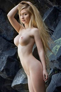 Mesmerizing blonde Acacia gets nude by the rocks and shows off her big tits and athletic body