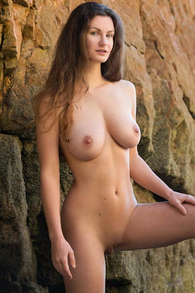 Irresistible brunette Susann gets nude on the rocks and shows off her hot curves