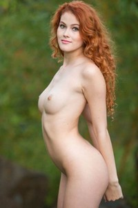 Amazing redhead vixen Heidi Romanova has an irresistible pair of natural tits with small nipples