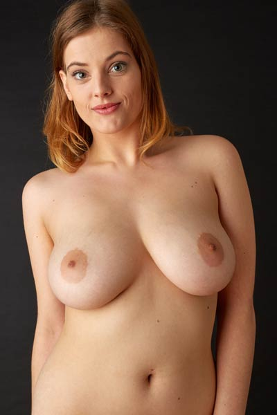 Seductive babe bares her huge natural and beefy cunt for a photo shoot