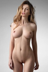 Mesmerizing big titted doll poses naked displaying her perfect skin