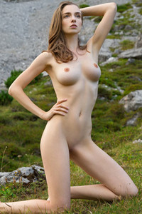 Exotic beauty showing off her petite but well endowed body in nature