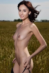 Her skinny body looks so hot while she poses naked outdoors