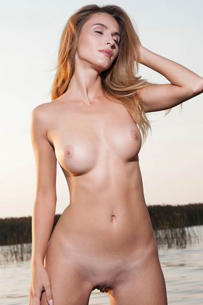 While she poses naked in the cold water her yummy small nipples get all stiff and erect