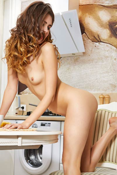 Adorable curly girl Luna Moonie presents her tight body in the kitchen