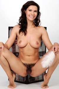 Good looking young brunette Susi R is all the way up with senusal posing