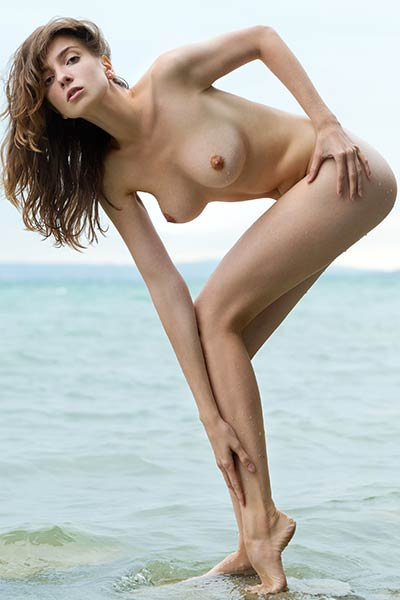 Take a break and look at this hot and horny young redhead chick