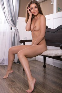 Top class skinny brunette Davina E lets us see her juicy pussy in nice solo action