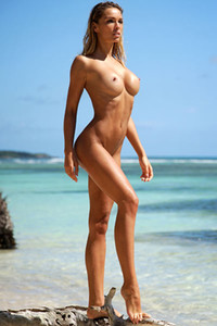 Gorgeous girl Amber A shows her attractive young body on the beach