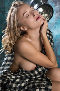 Stunning young blonde Vika P is all about playful naked posing on the sofa