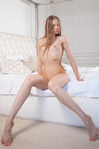 Super cute girl Nimfa B is presenting us with her superb body in the bedroom