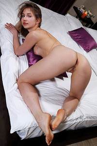Anna Di is rolling naked and posing on the bed showing off every inch of her sexy body