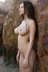 Magnificent busty female Alisa I shows off her gorgeous feminine curves at the beach