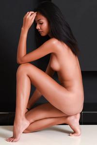 Smoking hot Asian beauty flaunts her delightful slender body